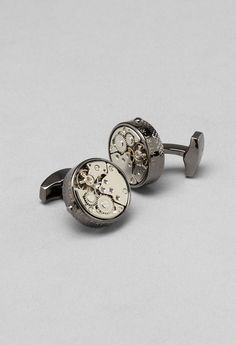 Very cool - Cufflinks with clock engine inside!