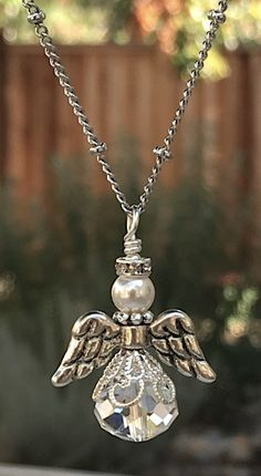 A personal favorite from my Etsy shop https://www.etsy.com/listing/106579521/guardian-angel-charm-necklace-crystal