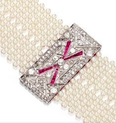 [DETAIL] PLATINUM, WHITE GOLD, CULTURED PEARL, DIAMOND AND RUBY CHOKER NECKLACE. Composed of cultured pearls measuring approximately 3.5 to 3.0 mm., accented by an openwork plaque and two diamond-set bars set with old European-cut, rose-cut and round diamonds weighing approximately 3.75 carats, and calibré-cut rubies, length 14 inches. Art Deco or Art Deco style