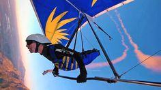 A dizzying aerobatic sunset hang gliding run with smokes