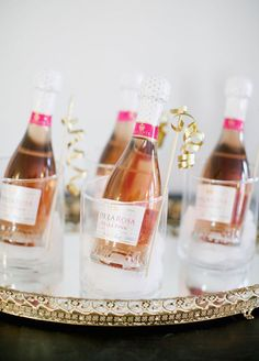 12 Best Edible Wedding Favors: #9. Time to get it popping! Guests can continue the celebration after the party ends with mini bottles of pink champagne.