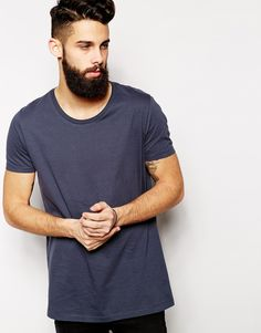 """Plain T-shirt by ASOS Soft -touch jersey Round neck Relaxed fit Longline cut Cut longer than standard length Machine wash 100% Cotton Our model wears a size Medium and is 5'11.5cm/181"""" tall"""