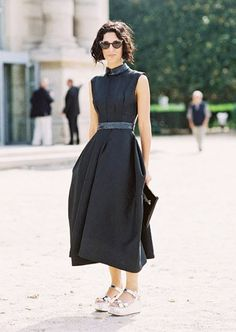 Yasmin Sewell wears a black midi dress with silver platform sandals and cat-eye sunglasses