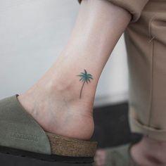 palm tree #palmtreetattoo #treetattoo #minitattoo #ankletattoo #colortattoo…