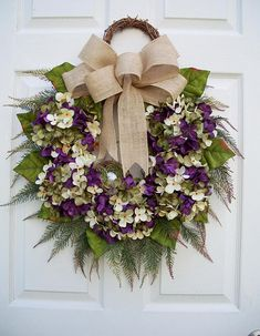 ******Vineyard Garden******* A wonderful addition to any front door. A nice way to welcome your family and friends any time or season. This wreath comes in many different color hydrangeas. Nice to match for a season, holiday or to match or accent the color of your house. This wreath has a small grapevine round hook at the top adding a decorative feature, as well as, a hook for the wreath. I love making items that are unique and a bit different. This wreath has 5 variegated hydrangeas in i...