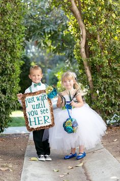 "I like the idea of having a ""Just wait until you see her"" sign. (Not this design)  I would so make my little nephew do this, with my little niece as the flower girl :)"