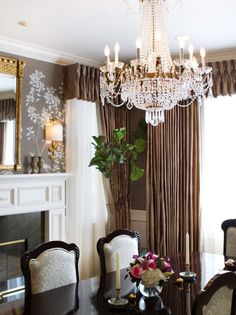 British Colonial dining room decor with Empire style crystal chandelier; dining room design and decorating ideas; dining room chandeliers
