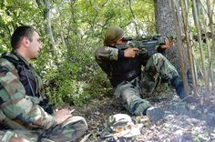 A sniper is taking aim at Ossetian soldiers in South Ossetia to make sure the small Georgia army unit can move forward. File:Georgian sniper during South Ossetia war. Sniper Training, World Library, South Ossetia, Ebooks Online, German Army, Troops, Soldiers, The Republic, British Army