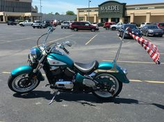 Regal turquoise metallic. Inspiration was a 1958 Corvette. American flag scarf tied to sissy bar.