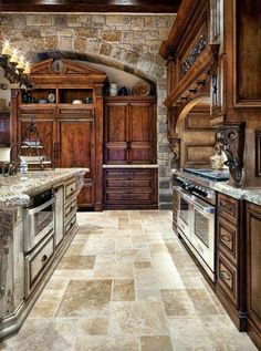 Old World Tuscan Themed Kitchen Style With Arched Brick Wall. Warm tones without being dark like a dungeon!
