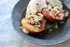 Grilled Peaches With Raspberry Butter And Amaretti Cookie Crumbs