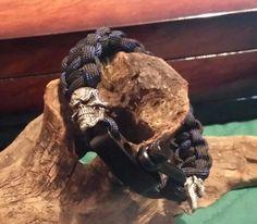Pewter skulls with adjustable shackle.
