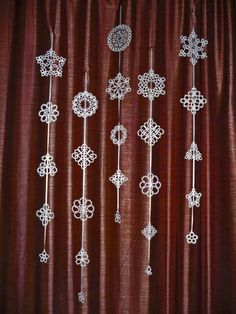 Tatting Christmas garland white snowflakes .