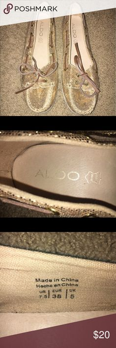 ALDO Sparkly Gold Boat Shoes ALDO Sparkly gold slip-ons. Size 7.5. Lightly worn - in great condition. Aldo Shoes Flats & Loafers