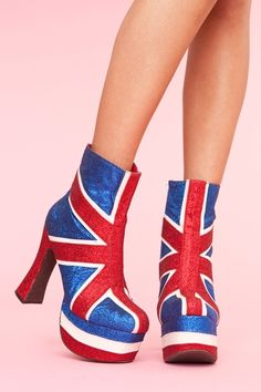 Red, white and blue glitter platform boots featuring a Union Jack design. Chunky tapered heel, side zip closure. Leather interior. By Jeffrey Campbell. $158.00