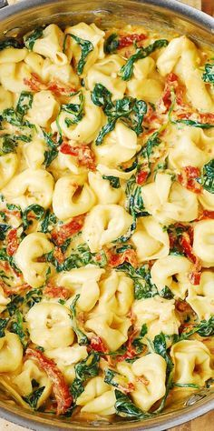 Creamy Sun-Dried Tomato, Basil & Spinach Tortellini smothered in a delicious Mozzarella Cheese sauce. Easy comfort food dinner made in 30 minutes! #pasta