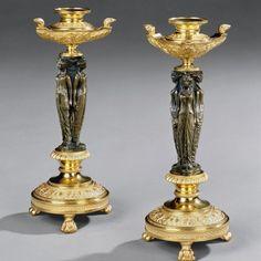 A Pair of Bronze and Ormolu Candlesticks c1810