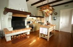 Rustic French farmhouse style kitchen with woodfired fireplace. #homeandstyleliving