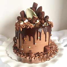 Kinder Egg Explosion Decadent chocolate cake layered with chocolate buttercream and topped with loads of chocolate pieces :)
