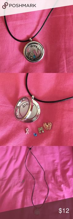 NWOT Origami Owl style necklace with 4 charms Origami owl style locket with black leather-like cord. Comes with a removable background inscribed with dream. This necklace will come along with 4 charms that can be changed: A blue stone, pink flip-flops, rhinestone M, and pink breast cancer awareness ribbon. I received this as a gift but never wore it. listed as origami owl for exposure. NOT GENUINE ORIGAMI OWL. origami owl Jewelry Necklaces