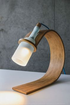Good wood - simple and sustainable lighting from new kid on the block Max Ashford. Using off-cuts of locally sourced oak and old wine bottles.