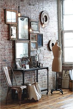 brick wall feature of mirrors and bulb pendants