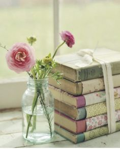 Cute way to display books - slip a scrapbook paper around binding and tie stack with ribbon!