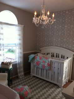 We love our grey & white nursery, (with coral pink & mint pop) for our baby girl! Stenciled accent wall & crystal chandelier really make it!!!
