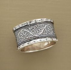 Within textured borders, hand cast vines creep and crawl around our exclusive, sterling silver ring. #SilverJewelry