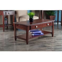 $123.  Amazon.com: Winsome Richmond Coffee Table with Tapered Leg: Kitchen & Dining