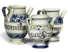 THREE ITALIAN MAIOLICA WET-DRUG JARS, FIRST HALF 18TH CENTURY, NORTH ITALIAN Comprising: a blue and white example inscribed in gothic script and dated 1745 to handle, a similar smaller example, another named in manganese script between polychrome bands of scrolls and foliage