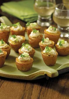"""This is a textbook example of the """"work early, relax later"""" school of appetizers. Cheesy, twice-baked potatoes get salty crispness from bacon bits and warm spice from Spanish pimenton."""