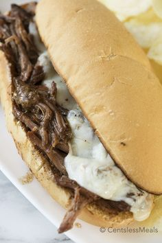 Crock Pot Italian beef turn an inexpensive cut of beef into an irresistible and tender meal!