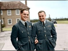 Two Duxford-based Battle of Britain pilots. Squadron Leader Douglas Bader, commanding No. 242 (Canadian) Squadron, with Major Alexander 'Sasha' Hess, CO of No. 310 (Czechoslovak) Squadron, outside the Officers Mess building, Duxford, Cambridgeshire. October 1940.