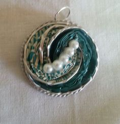 Ciondolo verde a spirale - fatto con capsule Nespresso