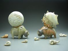 Makes me wonder why this is nice but I just like it?  Eva Funderburgh is a ceramic artist located in Seattle, Washington. Coming from an education in chemistry and sculpture, she has focused herself on making strange whimiscal clay creatures. She works on exploring the colors natural to the clay and the finishing process of woodfire, and strives to present creatures that equally mix whimsy, mischief, and threat.  evafunderburgh.com