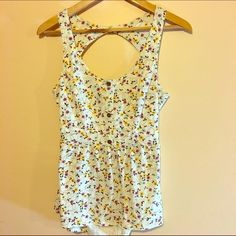 Pacsun Open Back O'Neill Top Floral open back top from Pacsun. Brand is O'Neill. Never worn!!! Would go great with a fitted black skirt, jeans, leggings, shorts, etc.. O'Neill Tops Tank Tops