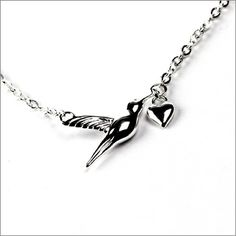Silver Hummingbird Charm Necklace  £56