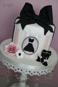 Black Bow Hat Box Cake. Not sure about the bow, but the accessories are cute. Could make a small round and place on black cake stand on top of a cute hat box. Decorate cupcakes for coordinating extras.