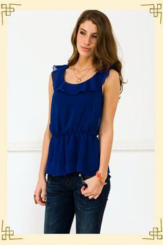 Love the neckline, ruffles, and color!