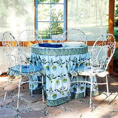 """Build an Outdoor Room This Weekend      Windows were placed next to the table and in the roof of this structure to further enhance the room-like atmosphere. Keep the curtain """"walls"""" open to take in the view, or slide them closed for an intimate dinner.        Tip: Prevent extra wear to your outdoor curtains by hanging them high enough to clear the ground."""