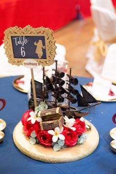 Disney Wedding centerpiece - pirates of the Caribbean wedding tables Marketplace wedding centerpieces Disney Wedding Centerpieces, Flower Centerpieces, Wedding Decorations, Wedding Arrangements, Centrepieces, Deco Disney, Disney Theme, Diy Wedding On A Budget, Wedding Ideas