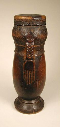 Africa | Drum from the Kuba people of DR Congo | Wood, hide, plant fiber and metal | Mid 20th century