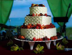 white wedding cake with fruit accents.    borterwagner photography        borterwagner.com