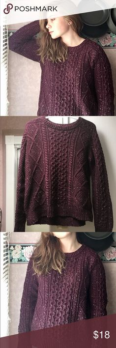 Merona Purple Cable Knit Sweater 72% polyester, 26% acrylic, 2% metallic Not see through even though it's knit. Thick and warm. Color is somewhere between burgundy and purple with little pink specks thrown in. Only worn a few times. The stock photo has the plus size version, while this runs a little big it's not plus size. Could fit a medium to L, mayyybe XL. Could also fit a small if you want that oversized look Merona Sweaters Crew & Scoop Necks