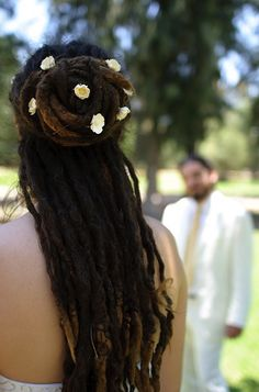 Just lovely. #dreads #updo #flowers