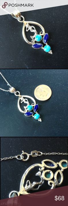 Turquoise & Lapis Mermaid Necklace Gorgeous mermaid necklace is accented by two round, natural copper-blue turquoise stones and two, marquise shaped lapis stones. Both pendant and chain are stamped.925 sterling silver. Handcrafted Jewelry Necklaces