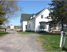 411 Pitch Off Rd, Plantagenet - $209,900 - MLS # 940337 - Two solid and spacious homes for the price of one! 2 three bedroom homes each with own hydro, propane gas and own furnaces on each side. Currently rented month to month below market value to family but huge potential. Very Large & Private property with enough acreage for huge workshop or tractor trailer parking with turnaround. Perfect for investor or live in one side and rent out other.