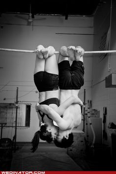 """this is from our engagement photo session. i'm an aerialist in cirque du soleil, and he's a gymnast. this was taken one week before i left on tour, sadly leaving him at home. at our wedding, we plan to walk down the aisle on our hands after we say """"i do."""""""