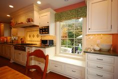 low kitchen window seat with cabinets built out on both sides...right side would be flex space, a desk, pantry, etc.